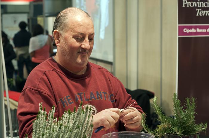 Man shaving vegetables at Salone del Gusto
