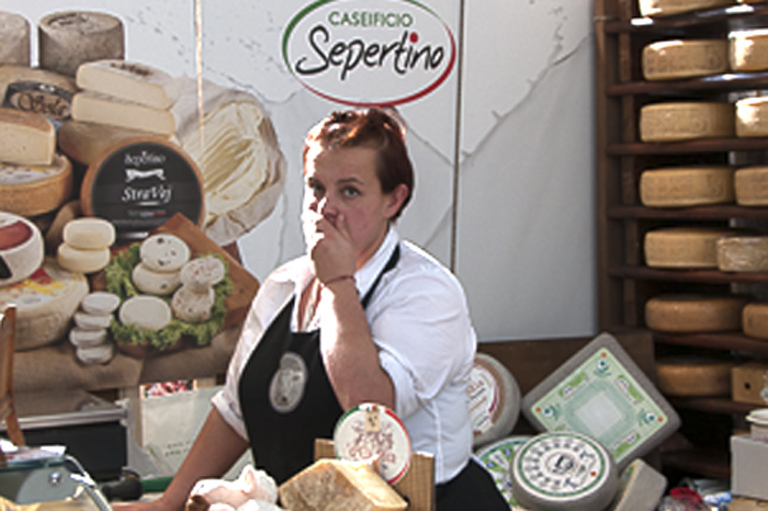 Reluctant cheese monger at Salone del Gusto
