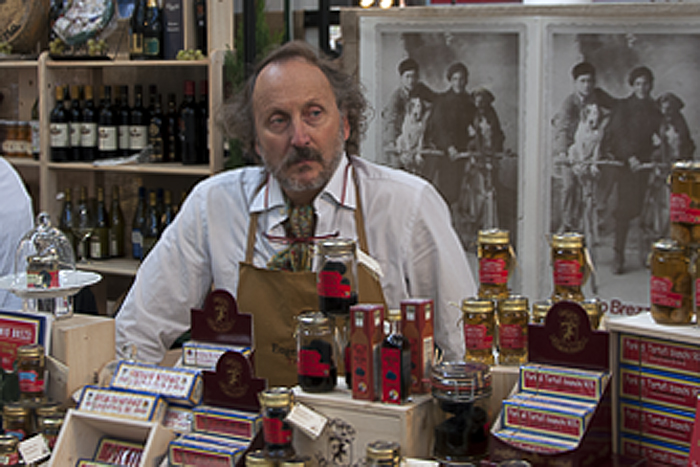 Theatrical anchovy vendor at Salone del Gusto
