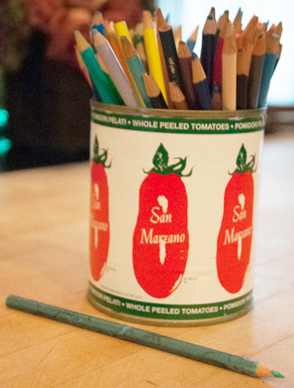 Tomato can full of colored pencils